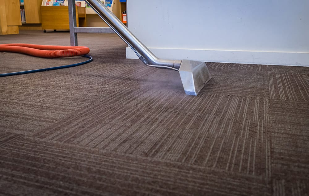 Commercial Carpet Cleaning, removing stains and soils from a carpet.