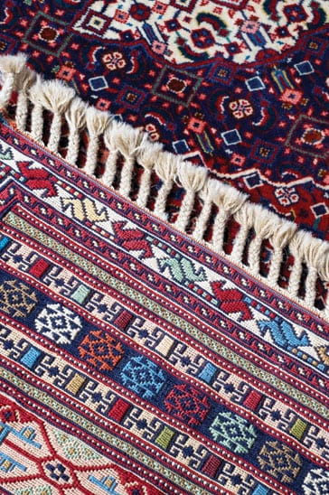 Cleaned Oriental Area Rug with vibrant colors.