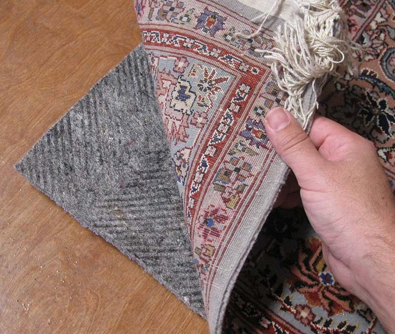Oriental area rug protected by rug pad by AmeriClean Cleaning Specialists.